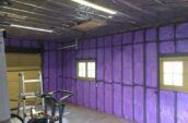 purple spray foam insulation covering walls of garage