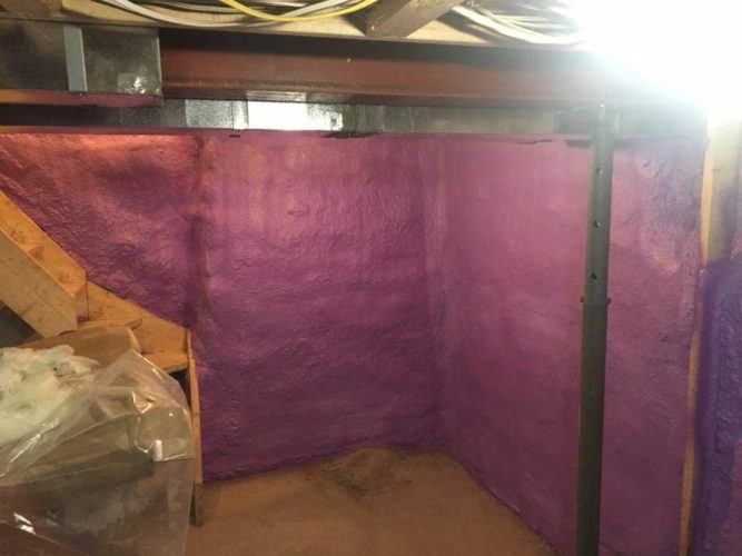 purple spray foam insulation covering walls of basement