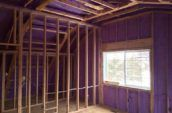 purple spray foam insulation covering walls in house