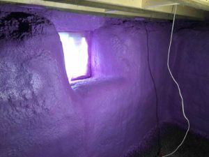 purple spray foam insulation covering basement walls