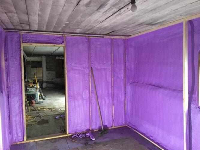 purple spray foam insulation inside framing of office walls