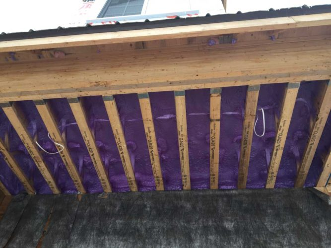 view of purple spray foam insulation for home floor from below